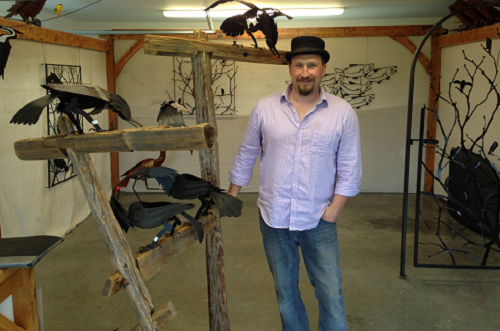 Steel artist Gunter Reimnitz with a few of this year's flock