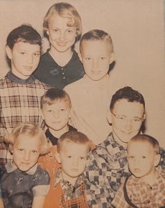 Melanie with her Siblings (left top face)